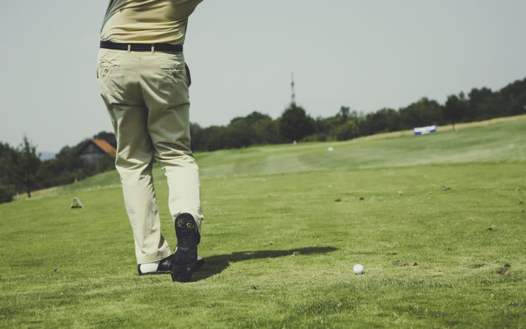 You've got your game on, now how do you level up? It all starts with perfecting your golf stance. Photo of golfer taking a swing.