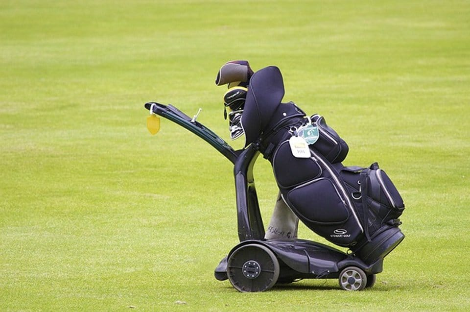 An electric golf push cart makes hitting the links a joy.