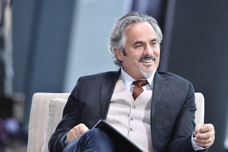 David Feherty sitting and smiling