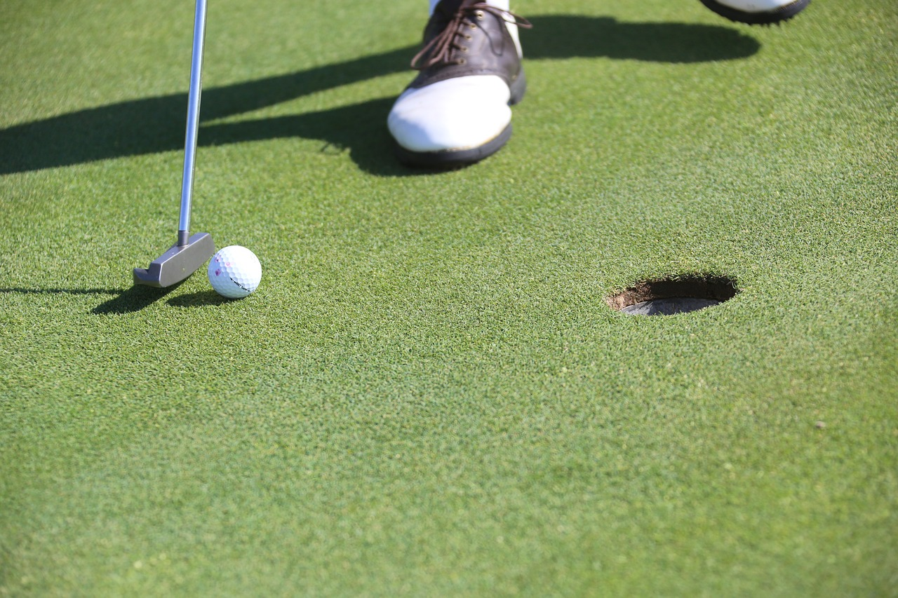 Golfer holding a club with a putter
