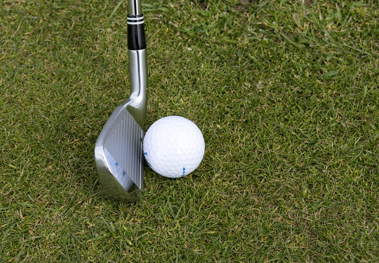 Putter with a golf ball on a lawn