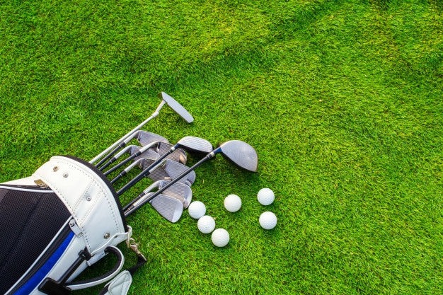 golf ball,  golf club bag on green grass