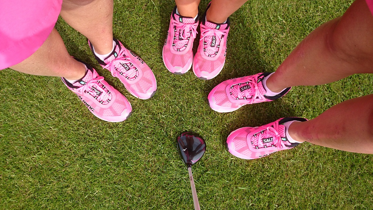 Three person wearing same kinds of golf shoe