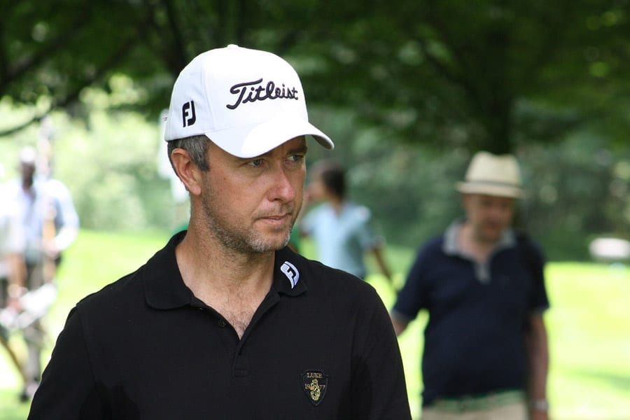 Image of Mark Foster wearing white cap and black shirt